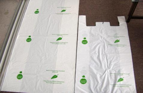 Left in picture the large 240 ltr wheeliebin liner G240. At right the G002 900h x 600+240w T-shirt